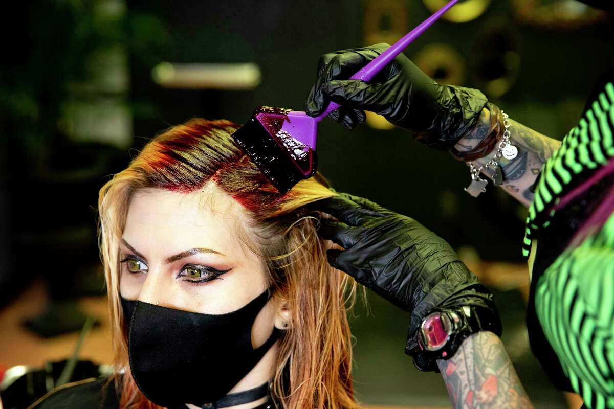 Crystal Duron, better known as Crystal Terror, works on the hair of longtime client Crystal Forsythe at Toxic Salon.