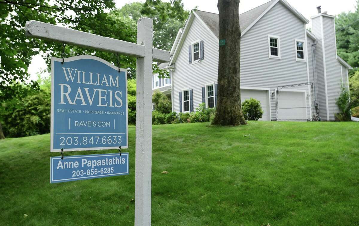 A Tally Drive home in Norwalk, Conn., which went under contract in July 2021 for $779,000 after just five days on the market, a 42 percent premium for what the sellers paid for it newly constructed in 2001.
