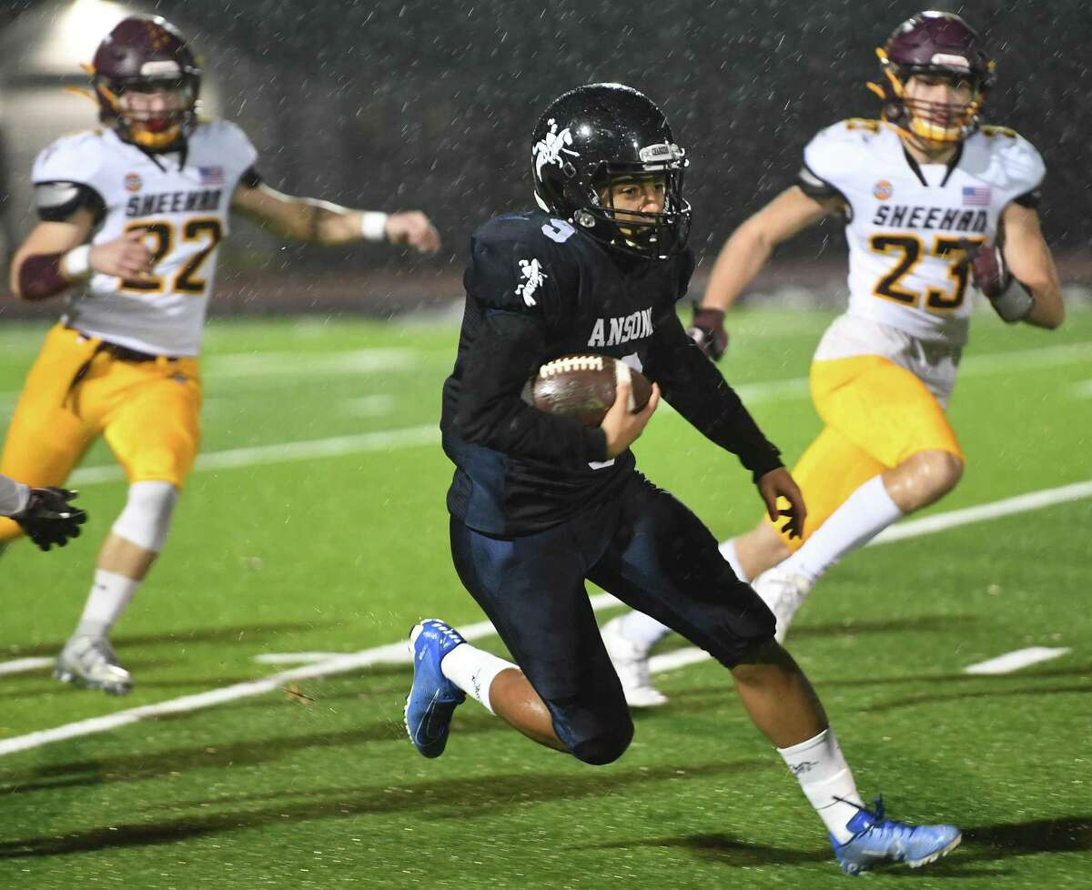 Ansonia's Darrell McKnight returns the opening kickoff for a long gain in the Class S semifinal game against Sheehan in 2019.