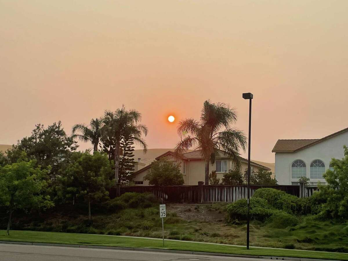 A hazy sunset is seen in Fairfield, Calif., as wildfire smoke fills the skies. Another air quality alert was issued for the Bay Area as wind pushes wildfire smoke south.
