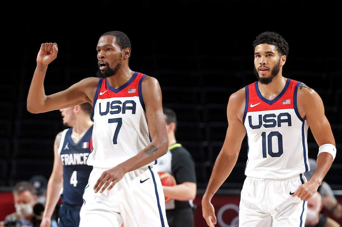 SAITAMA, JAPAN - AUGUST 07: Kevin Durant #7 of Team United States reacts against Team France as teammate Jayson Tatum #10 looks on during the first half of a Men's Basketball Finals game on day fifteen of the Tokyo 2020 Olympic Games at Saitama Super Arena on August 07, 2021 in Saitama, Japan. (Photo by Gregory Shamus/Getty Images)