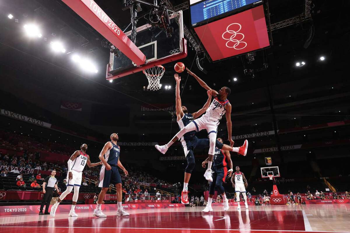 SAITAMA, JAPAN - AUGUST 07: Kevin Durant #7 of Team United States goes up for a dunk against Rudy Gobert #27 of Team France during the second half of a Men's Basketball Finals game on day fifteen of the Tokyo 2020 Olympic Games at Saitama Super Arena on August 07, 2021 in Saitama, Japan. (Photo by Gregory Shamus/Getty Images)