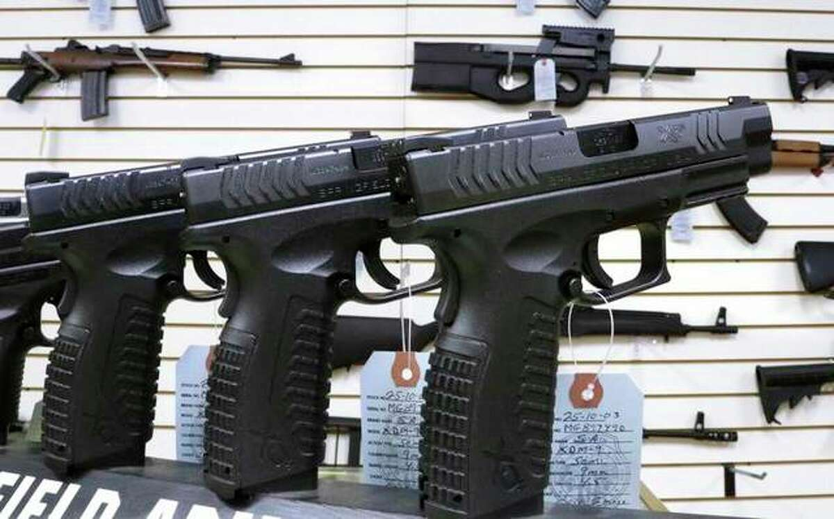 An assortment of firearms is displayed at Capitol City Arms Supply in Springfield.