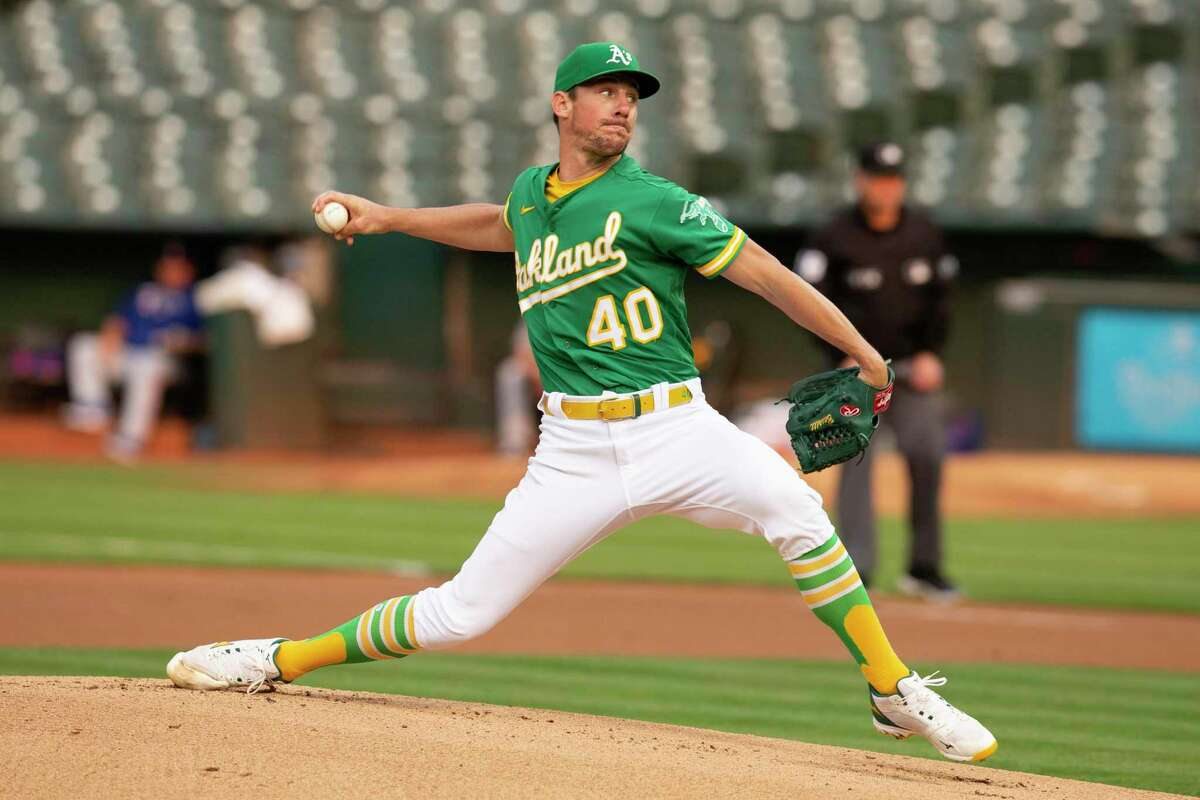 Oakland Athletics starting pitcher Chris Bassitt (40) delivers against the Texas Rangers during the first inning of a baseball game, Friday, Aug. 6, 2021, in Oakland, Calif. (AP Photo/D. Ross Cameron)