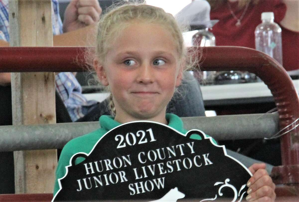Around 250 animals went on the auction block Friday morning during the Junior Livestock Association sale at the 2021 Huron Community Fair on Friday morning. The sale took place at the Dennis M. Hagen Show and Sale Arena, with hog, feeders, fats and sheep all up for auction. The sale, as well as the fair, returned after a two-hiatus due to the COVID-19 pandemic.