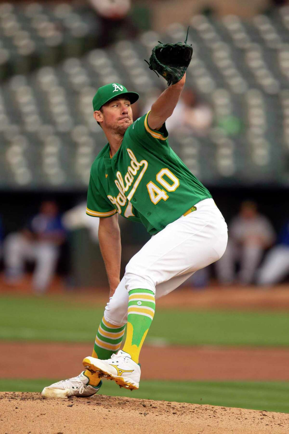 Oakland Athletics starting pitcher Chris Bassitt (40) delivers against the Texas Rangers during the second inning of a baseball game, Friday, Aug. 6, 2021, in Oakland, Calif. (AP Photo/D. Ross Cameron)