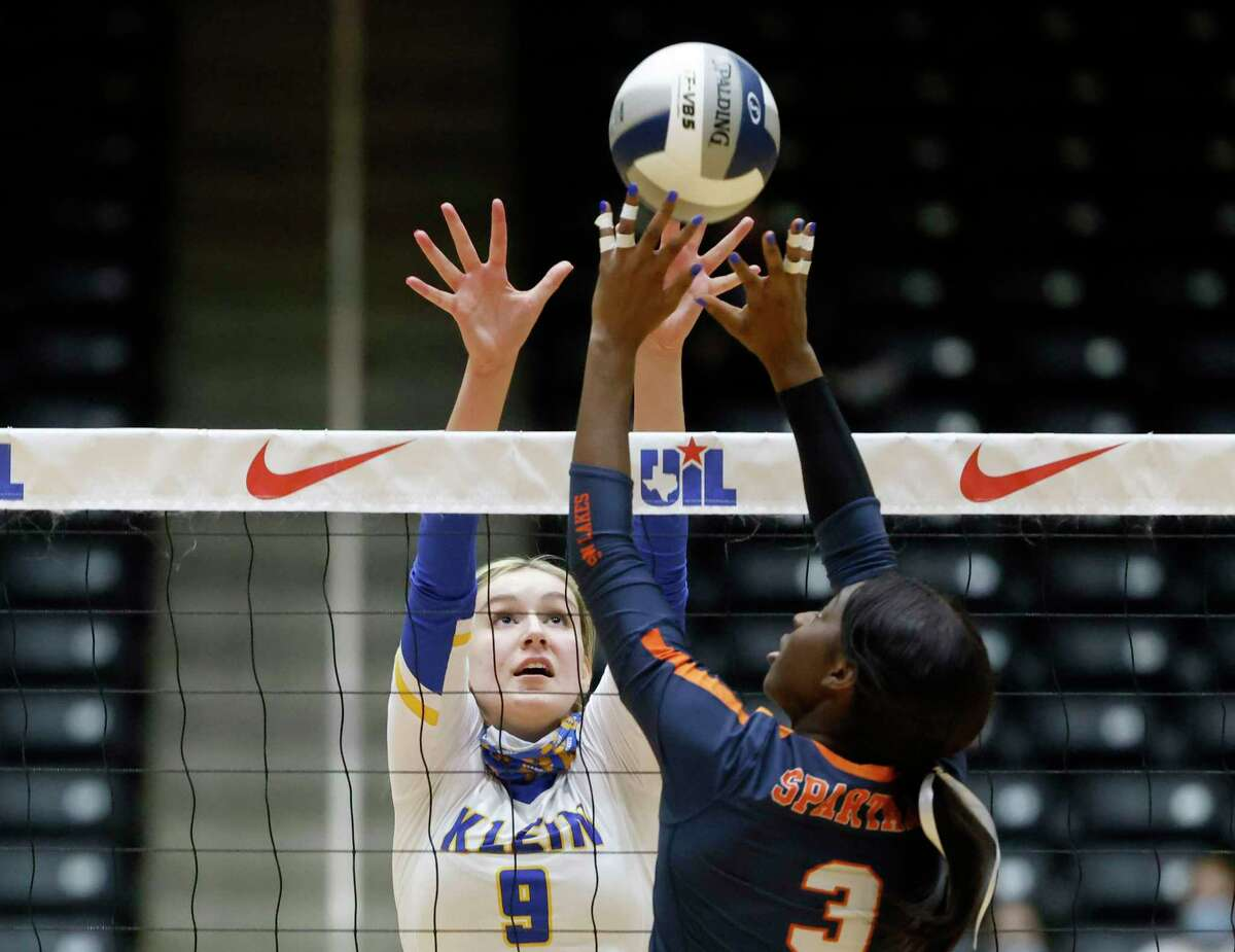 Klein player Kierstyn McFall (9) tries to block a shot by Mayo Olibale (3) during the Conference 6A State High School volleyball championship in Garland, Texas on Dec. 12, 2020.