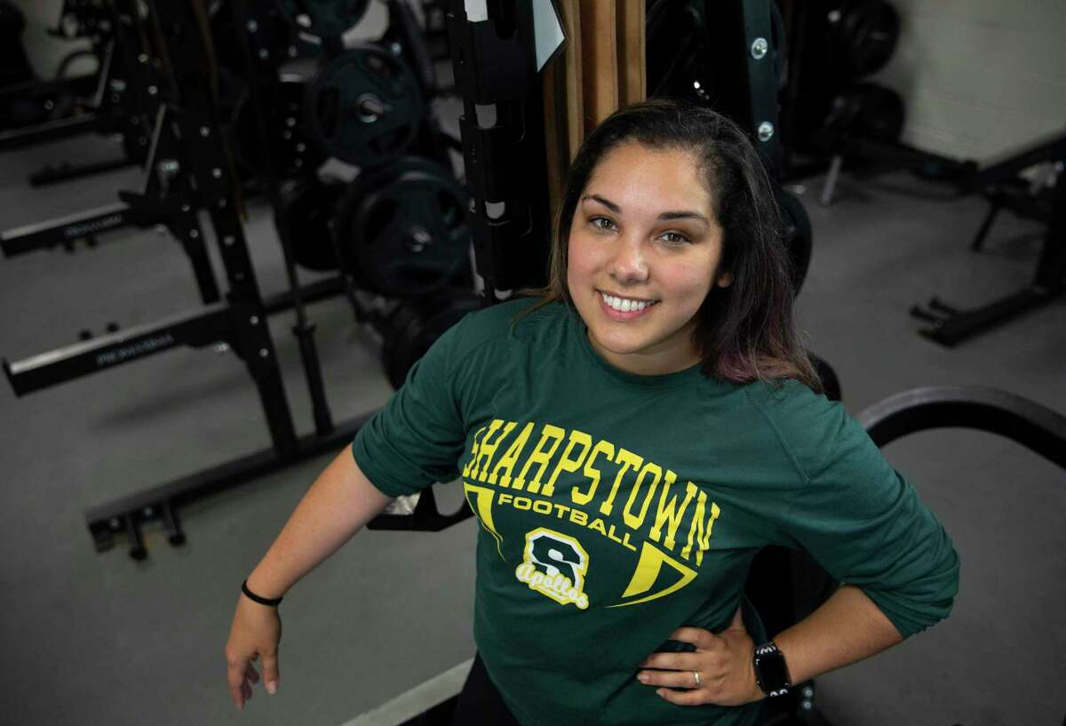 Sharpstown High School's strength and conditioning Coach Aislinn Garza poses for a photograph Wednesday, Aug. 4, 2021, in Houston. Garza is the only female strength and conditioning coach in Houston.