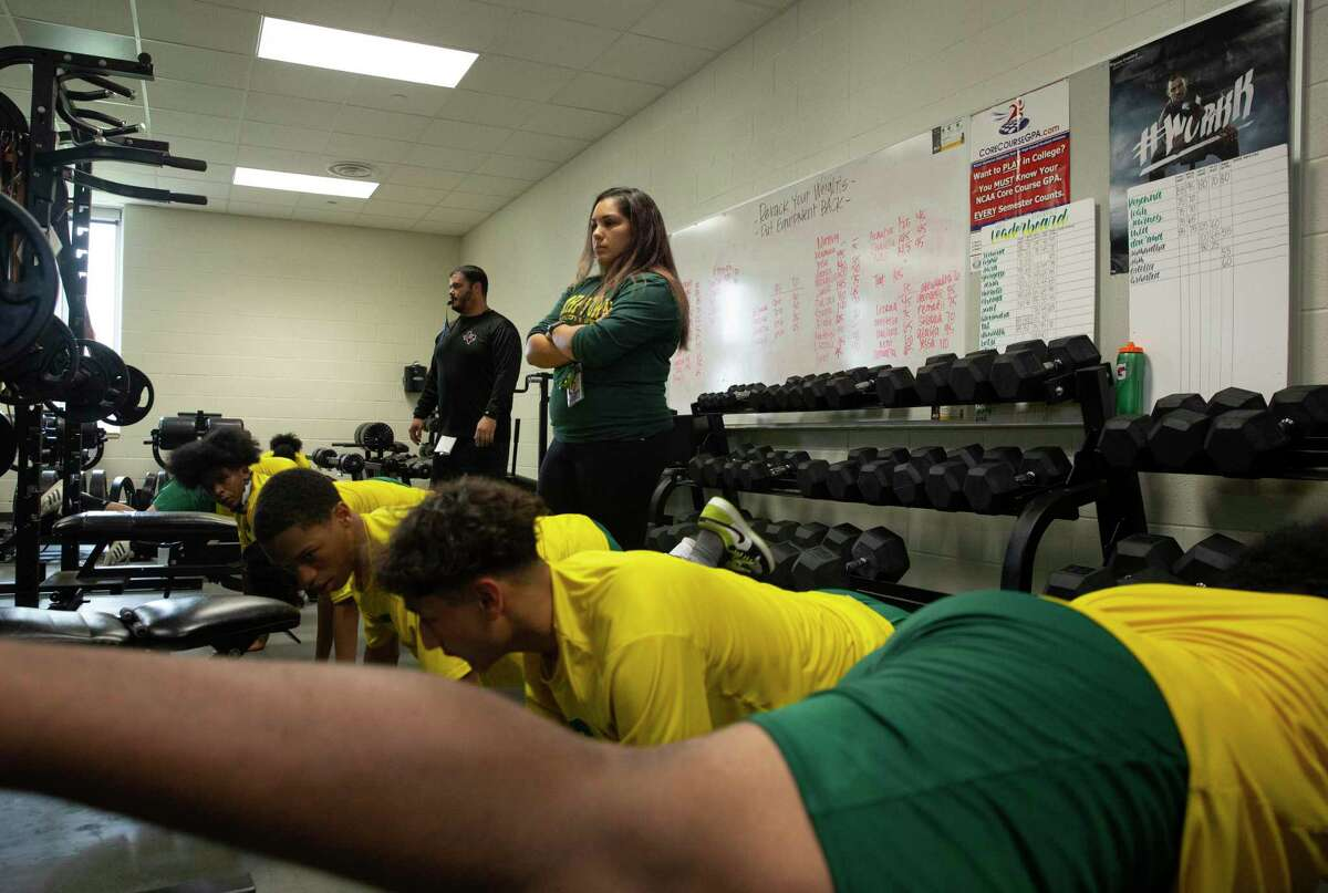 Sharpstown High School Strength and Conditioning Coach Aislinn Garza works with the football team during a training session Wednesday, Aug. 4, 2021, in Houston. Garza is the only female strength and conditioning coach in Houston.