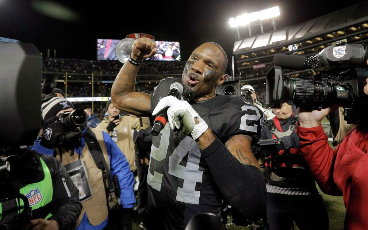 """Charles Woodson leads a chant of """"Raiders"""" after he was honored for his last home game at the Coliseum before his retirement in 2015. In his final season, he had five interceptions, forced a career-high four fumbles and make the Pro Bowl for a ninth time."""