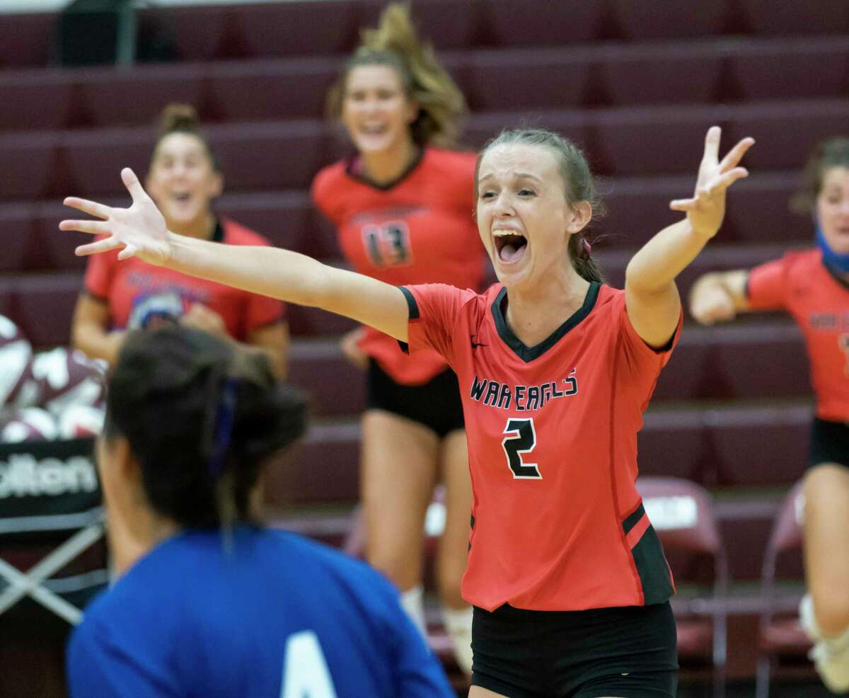 Oak Ridge setter Avery Fowler (2) runs to hug her teammates after they win the fifth set of a non-district volleyball match at Magnolia High School, Saturday, Sept. 19, 2020.