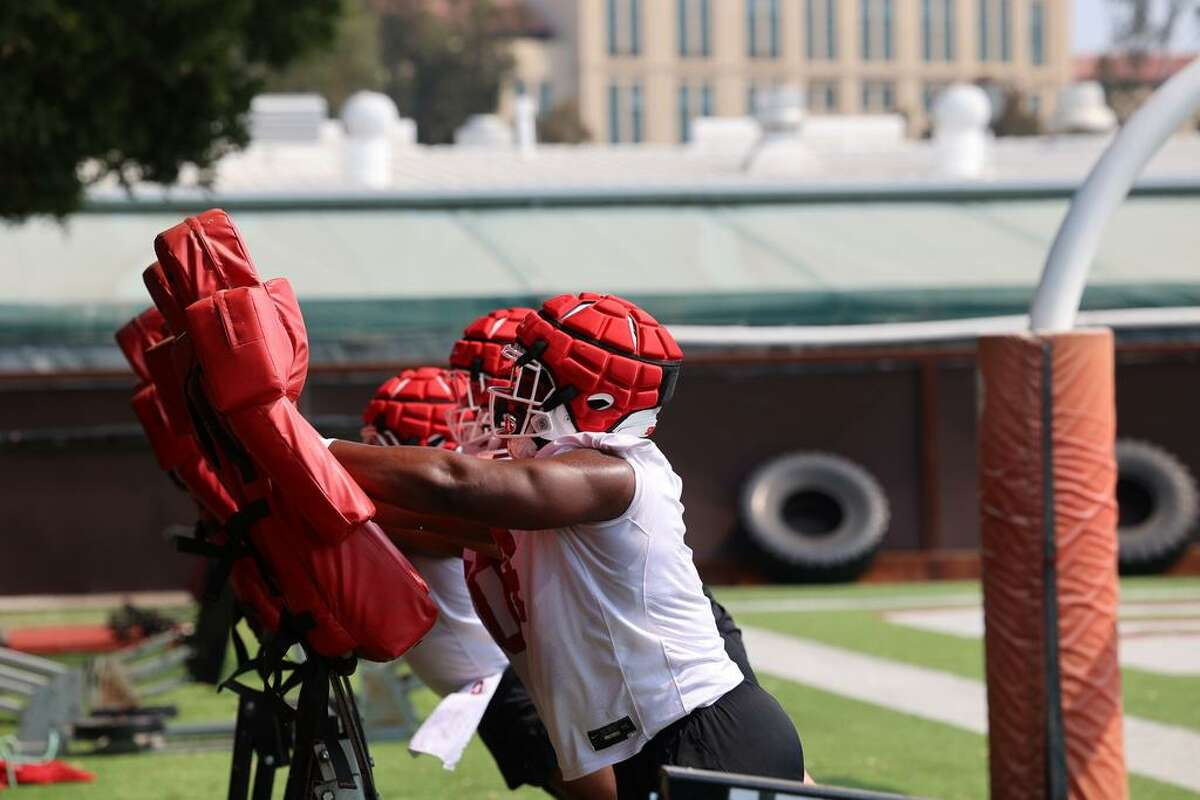 Stanford senior defensive lineman Thomas Booker goes through drills Friday, the first day of training camp after a coronavirus-shortened 2020.
