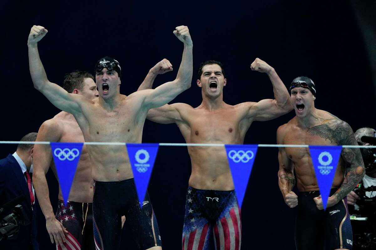 Caeleb Dressel, celebrating the U.S. victory in the 4x100 medley relay, finished with five golds.