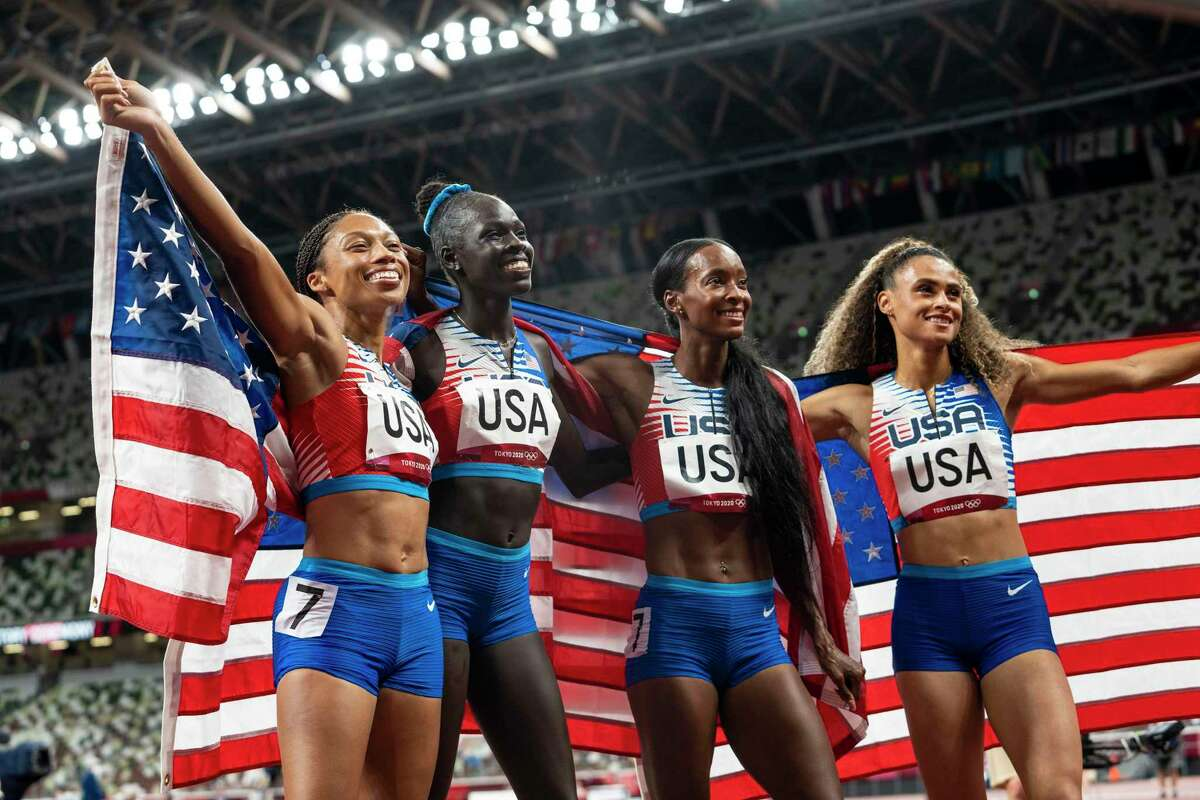 Members of the U.S. team, Allyson Felix, Dalilah Muhammad, Athing Mu, and Sydney Mclaughlin, from left, celebrate winning the gold medal in the women's 4 x 400-meter relay at the 2020 Summer Olympics, on Saturday, Aug. 7, 2021. Felix has won her 11th Olympic medal, making her the most decorated American Olympian in track and field, surpassing the 10 medals won by Carl Lewis. (Doug Mills/The New York Times)