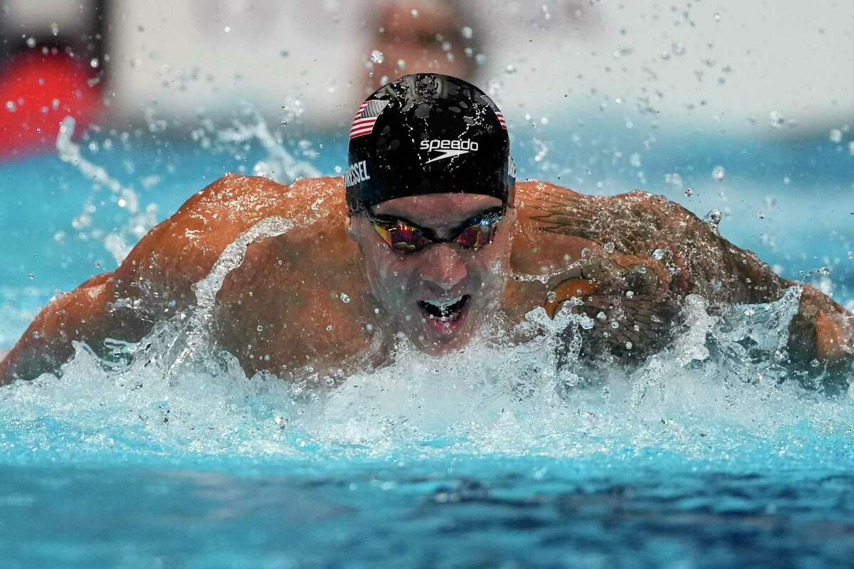 Caeleb Dressel, of the United States, swims in the men's 4x100-meter medley relay final at the 2020 Summer Olympics, Sunday, Aug. 1, 2021, in Tokyo, Japan. AP Photo/Gregory Bull)