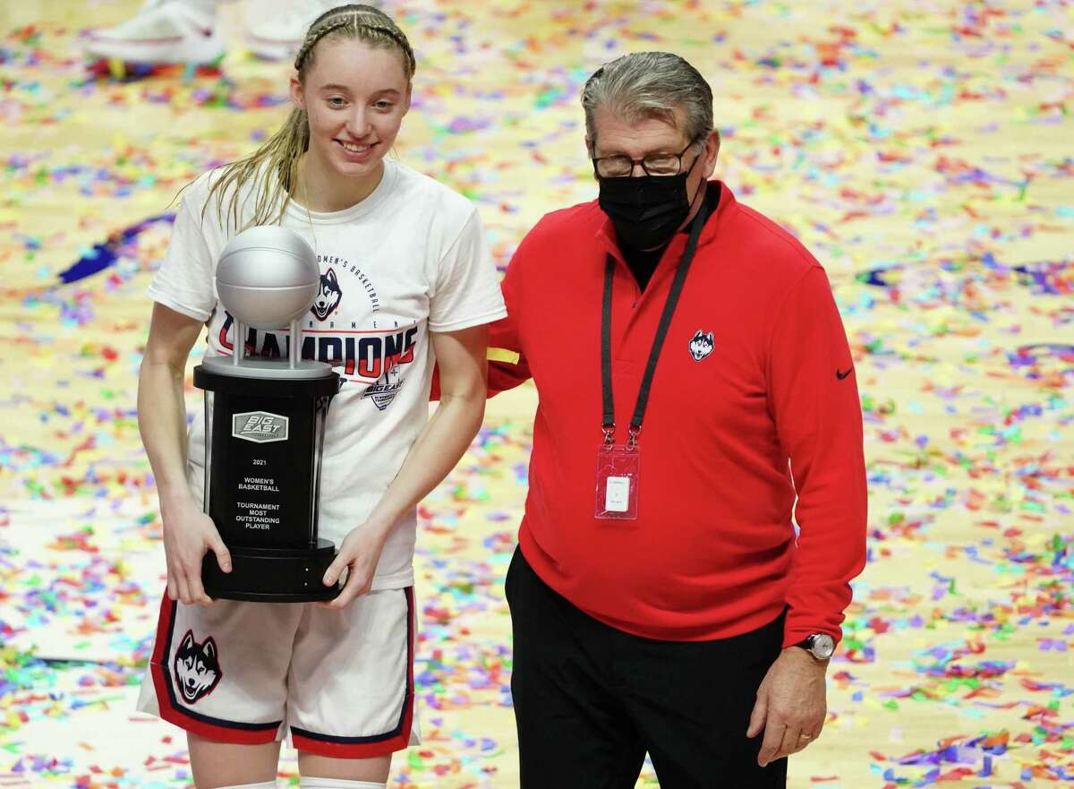 UConn Huskies guard Paige Bueckers (5) is awarded most outstanding player as she poses for a picture with head coach Geno Auriemma after defeating the Marquette Golden Eagles in the Big East Championship game at Mohegan Sun.