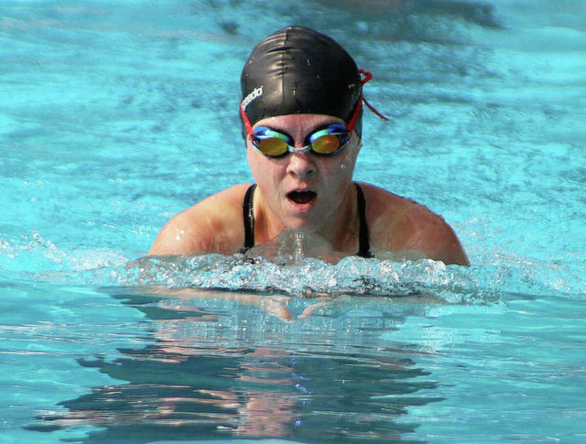 Lucy Luken Dehner does the breaststroke leg of the women's 100-yard medley relay at Saturday's Summers Port Sharks alumni swim meet.