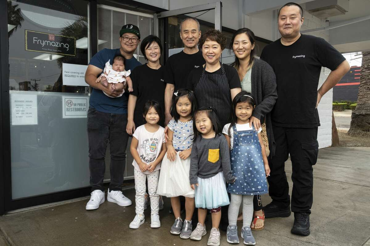 Husband and wife owners Yuh Il Yoon and Jong Ran Park, center, and their family at Frymazing in Vallejo.
