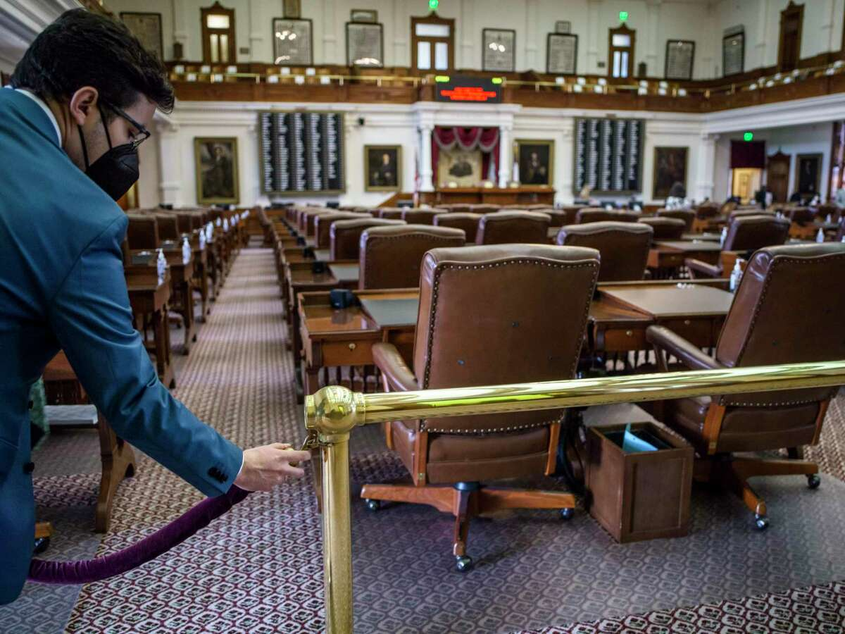A Texas House aide cordons off the Texas House Floor after the second special session called by Governor Greg Abbott was quickly adjourned due to a lack of a quorum on Saturday, August 7, 2021 in Austin, Tx., U.S. The Texas House of Representatives did not have a quorum due to a number of Texas House Democrats being absent and adjourned quickly after opening the session on Saturday afternoon.