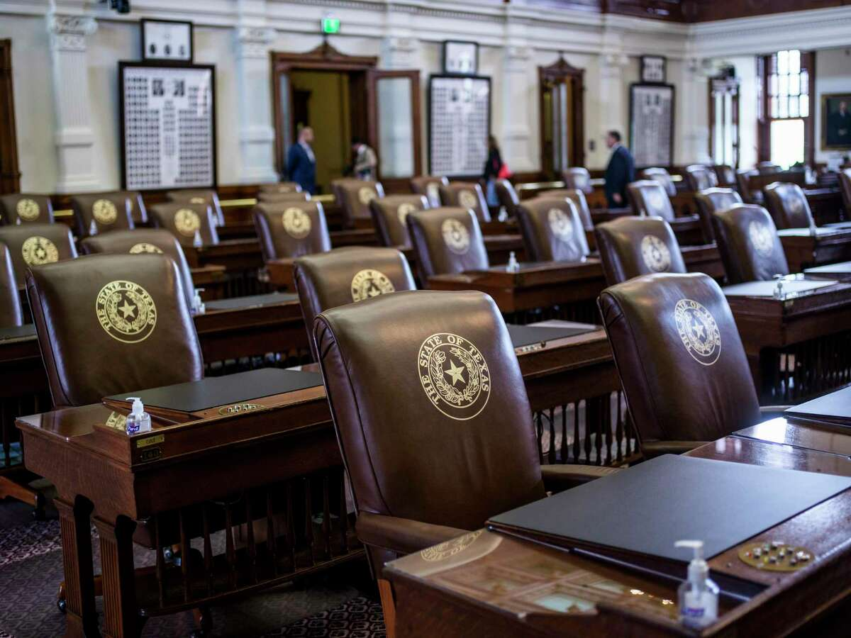 A number of seats sit empty as The Texas House of Representatives opens its second special session called by Governor Greg Abbott on Saturday, August 7, 2021 in Austin, Tx., U.S. The Texas House of Representatives did not have a quorum due to a number of Texas House Democrats being absent and adjourned quickly after opening the session on Saturday afternoon.