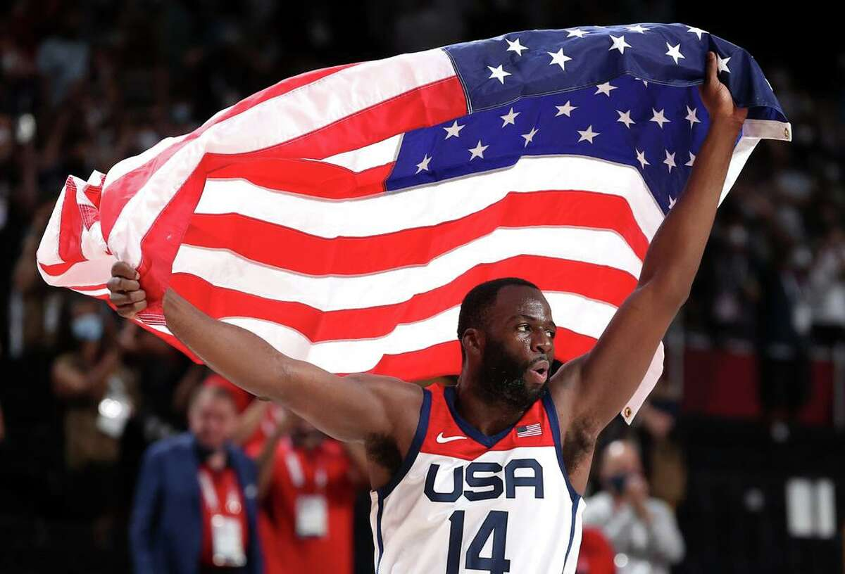 SAITAMA, JAPAN - AUGUST 07: Draymond Green #14 of Team United States celebrates following the United States' victory over France in the Men's Basketball Finals game on day fifteen of the Tokyo 2020 Olympic Games at Saitama Super Arena on August 07, 2021 in Saitama, Japan. (Photo by Gregory Shamus/Getty Images)