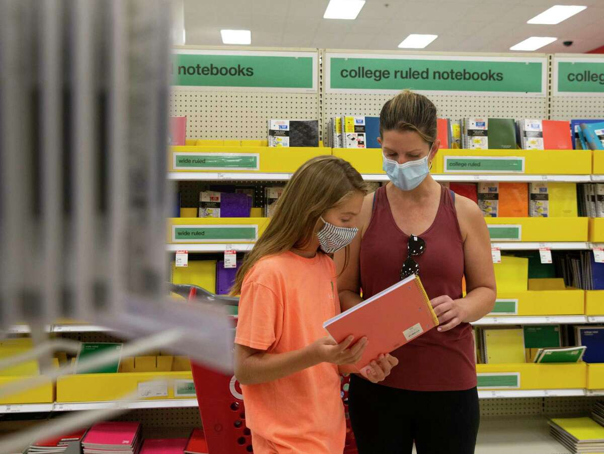 Sarah Homer and daughter Kate Homer, 11, shop for school supplies to prepare for new semester at Target during the tax-free weekend Saturday, Aug. 7, 2021, at Memorial City Mall in Houston.