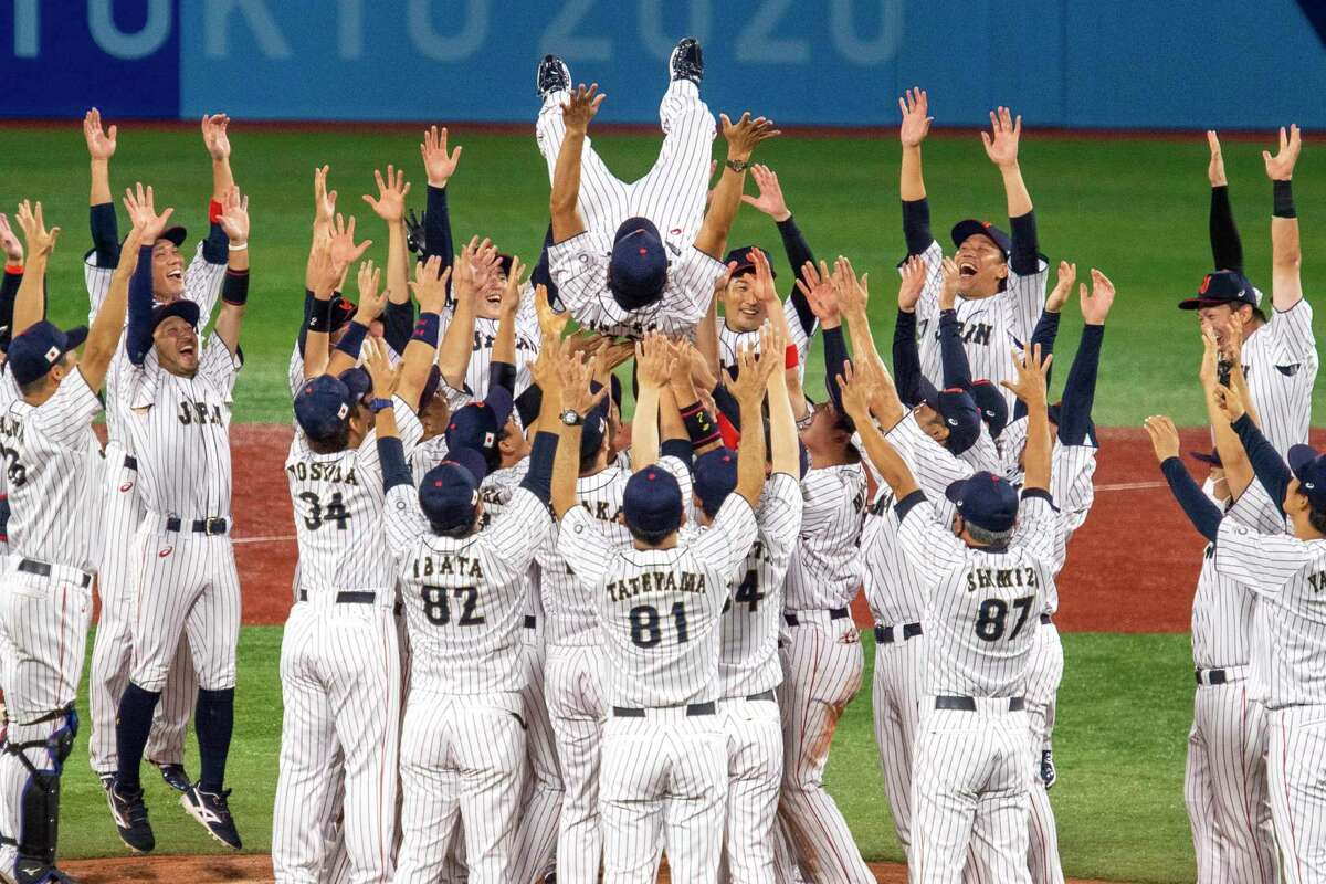 Team Japan celebrates after winning the gold medal baseball game against the U.S. at the postponed 2020 Summer Olympics, in Yokohama, Japan on Saturday, Aug. 7, 2021. Japan won 2-0. (James Hill/The New York Times)