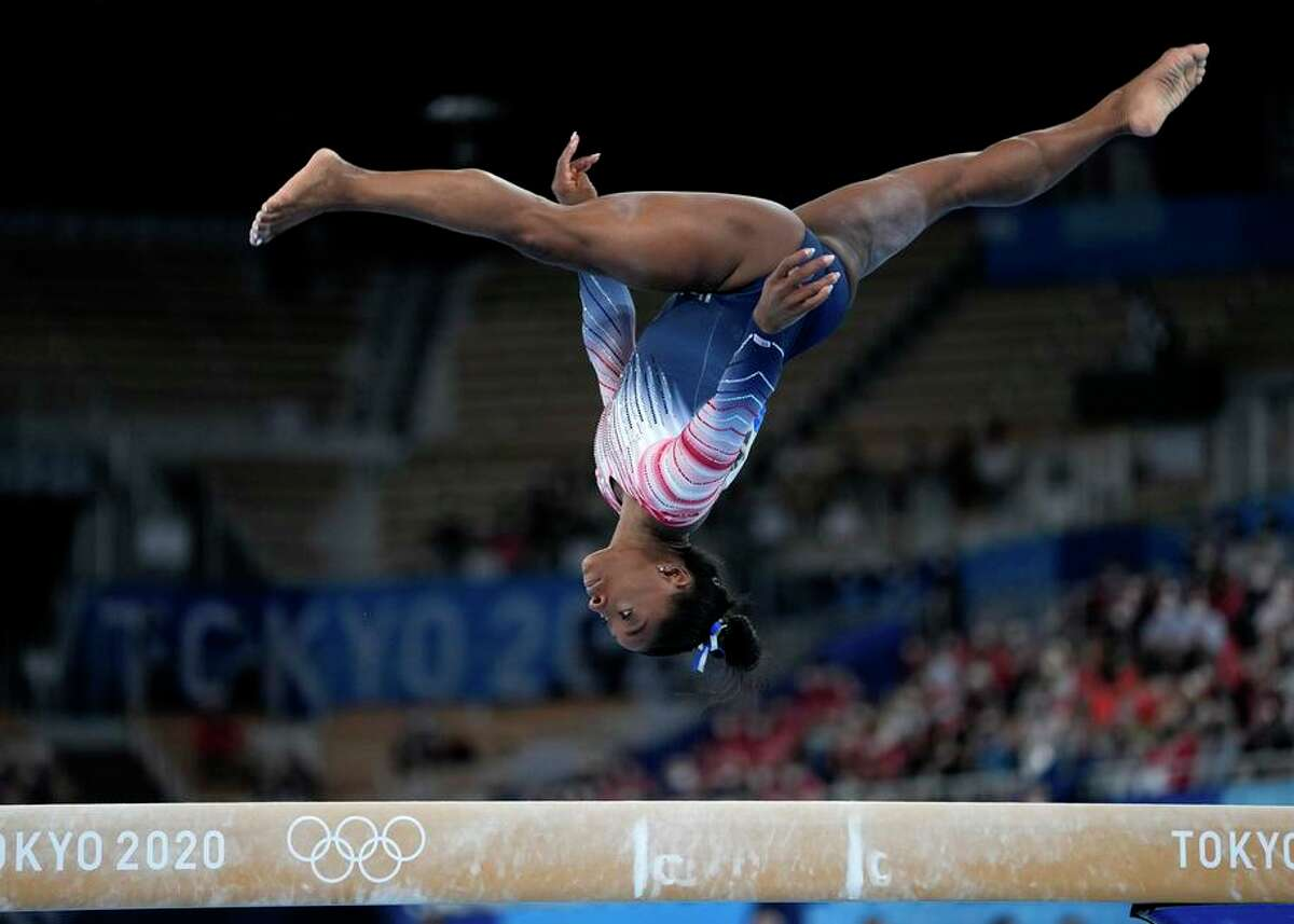 Simone Biles of the U.S. performs on the balance beam during the artistic gymnastics women's apparatus final at the 2020 Summer Olympics on Aug. 3 in Tokyo.