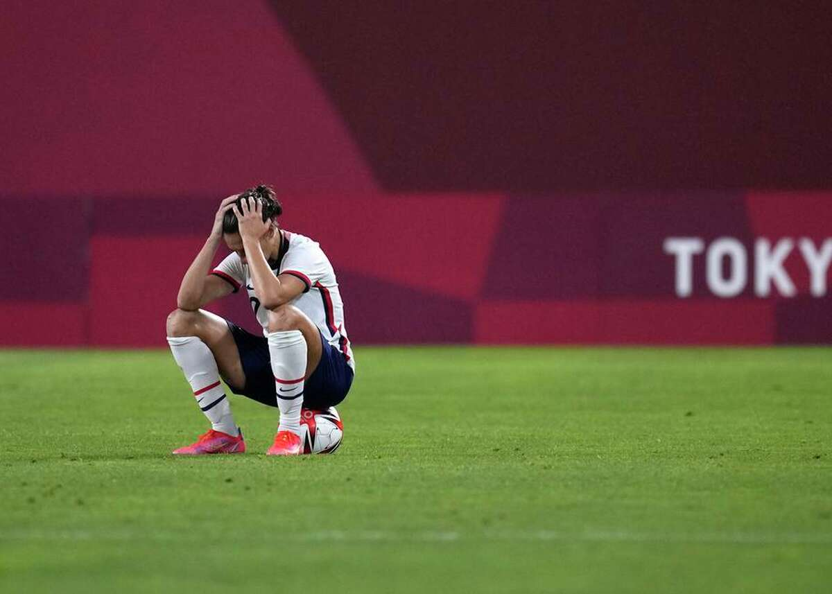 Carli Lloyd sits dejectedly after the U.S. was defeated 1-0 by Canada during a semifinal soccer match at the Summer Olympics on Aug. 2 in Kashima, Japan.