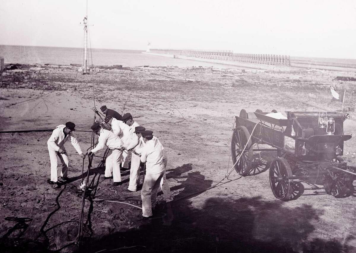 Life saving drill on Elberta beach in 1906 by the Life Saving Service crewmen, who are setting up the breeches buoy. (Courtesy Photo)