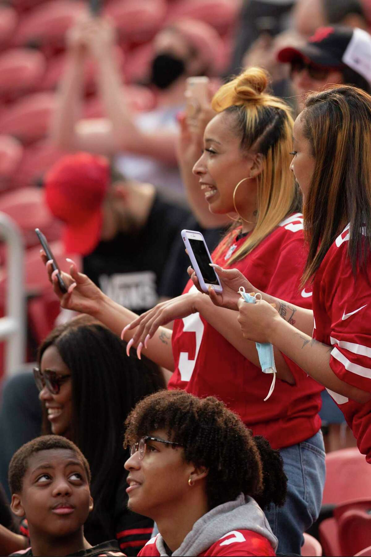 San Francisco 49ers fans arrive at Levi's Stadium for an NFL football open practice, Saturday, Aug. 7, 2021, in Santa Clara, Calif. Fans were allowed back inside Levi's Stadium for the first time since the onset of the COVID-19 pandemic. (AP Photo/D. Ross Cameron)