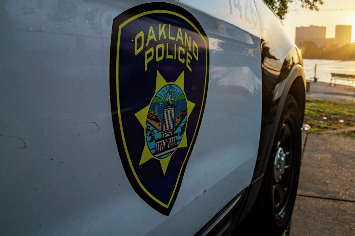 An Oakland police car. An armed suspect was taken into custody early Wednesday shortly after allegedly shooting an Oakland police officer, officials said.