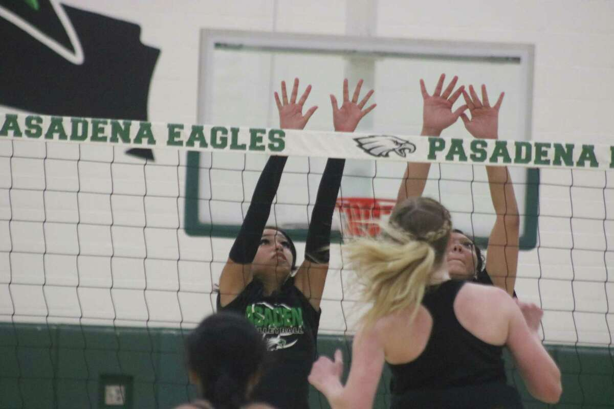 The Pasadena duo of Alyza Jarmillo (left) and Momeserrap Montalvo form an attempted block party against a Morton Ranch hitter Saturday afternoon.