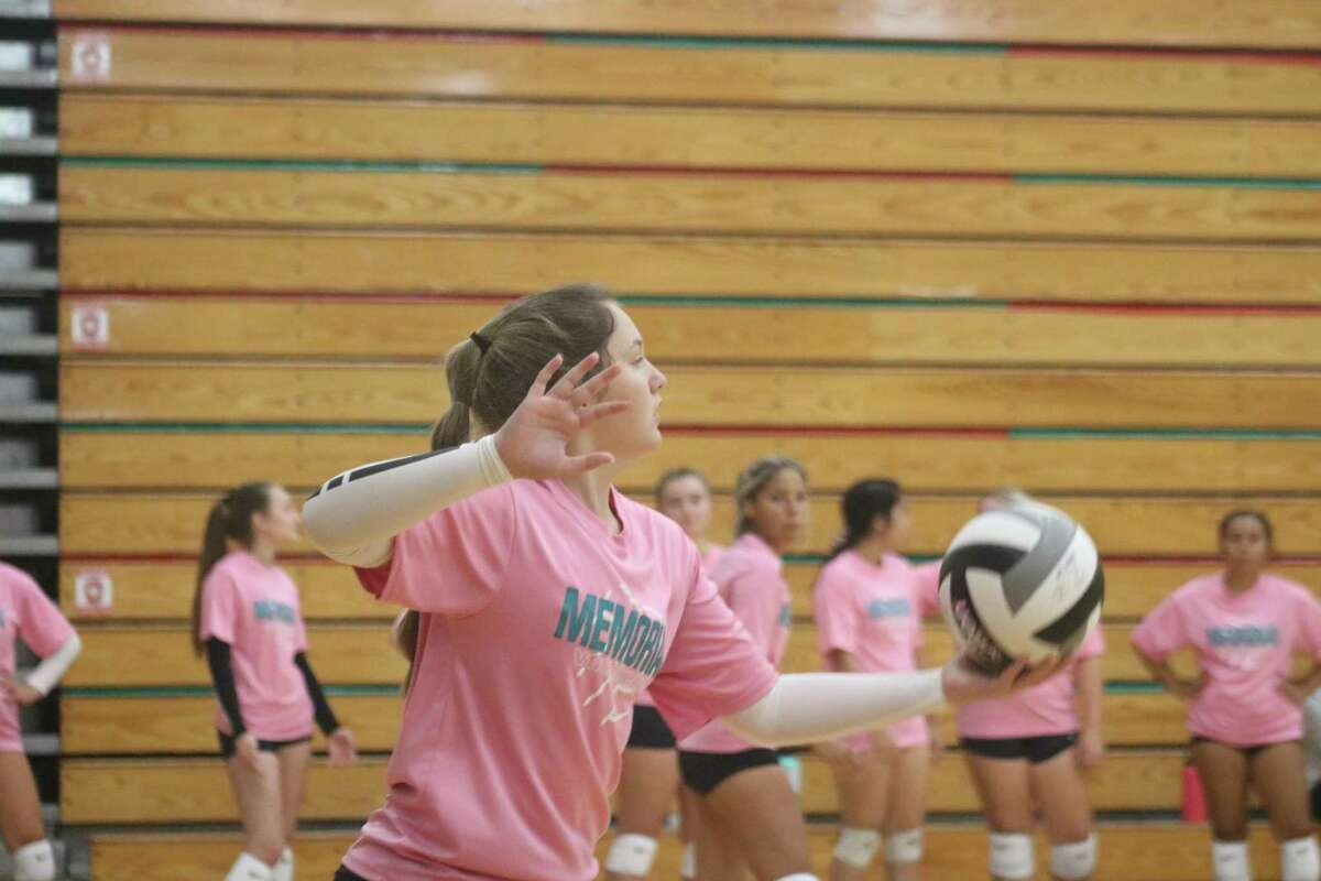 Memorial's Haley Salisbury prepares to serve the ball against Humble on Friday. Salisbury served well during the team's opening set of scrimmages.