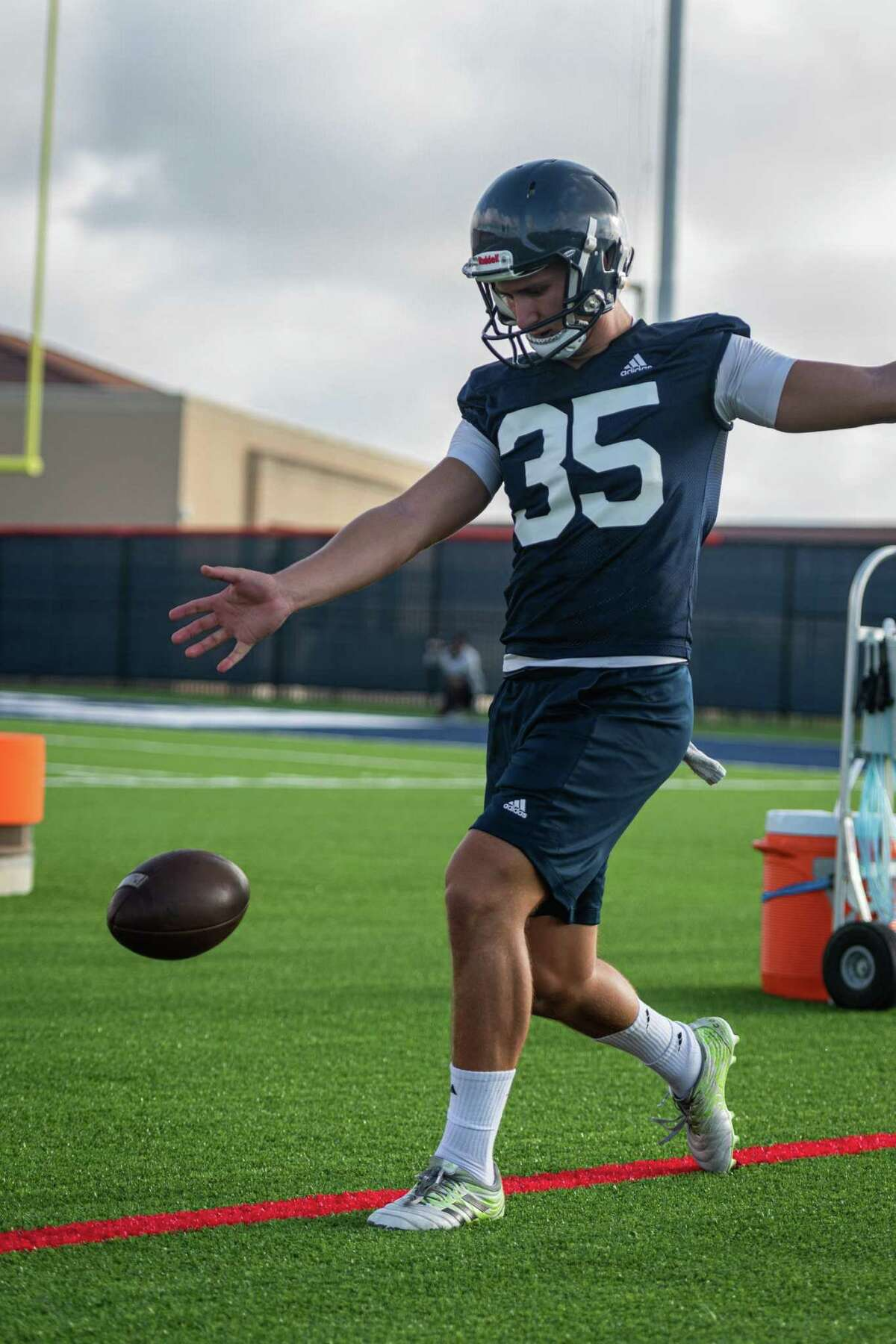 On Saturday morning of August 7th, 2021, UTSA's football team holds practice on the field by the new Roadrunner Athletic Center of Excellence (RACE) in San Antonio, Texas. Here, Punter Lucas Dean practices kicks.
