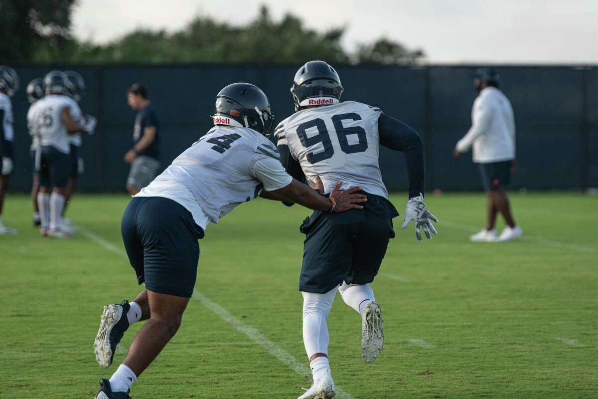 On Saturday morning of August 7th, 2021, UTSA's football team holds practice on the field by the new Roadrunner Athletic Center of Excellence (RACE) in San Antonio, Texas. Here, Outside Linebacker Charles Wiley (No. 96) runs drills with his teammates.