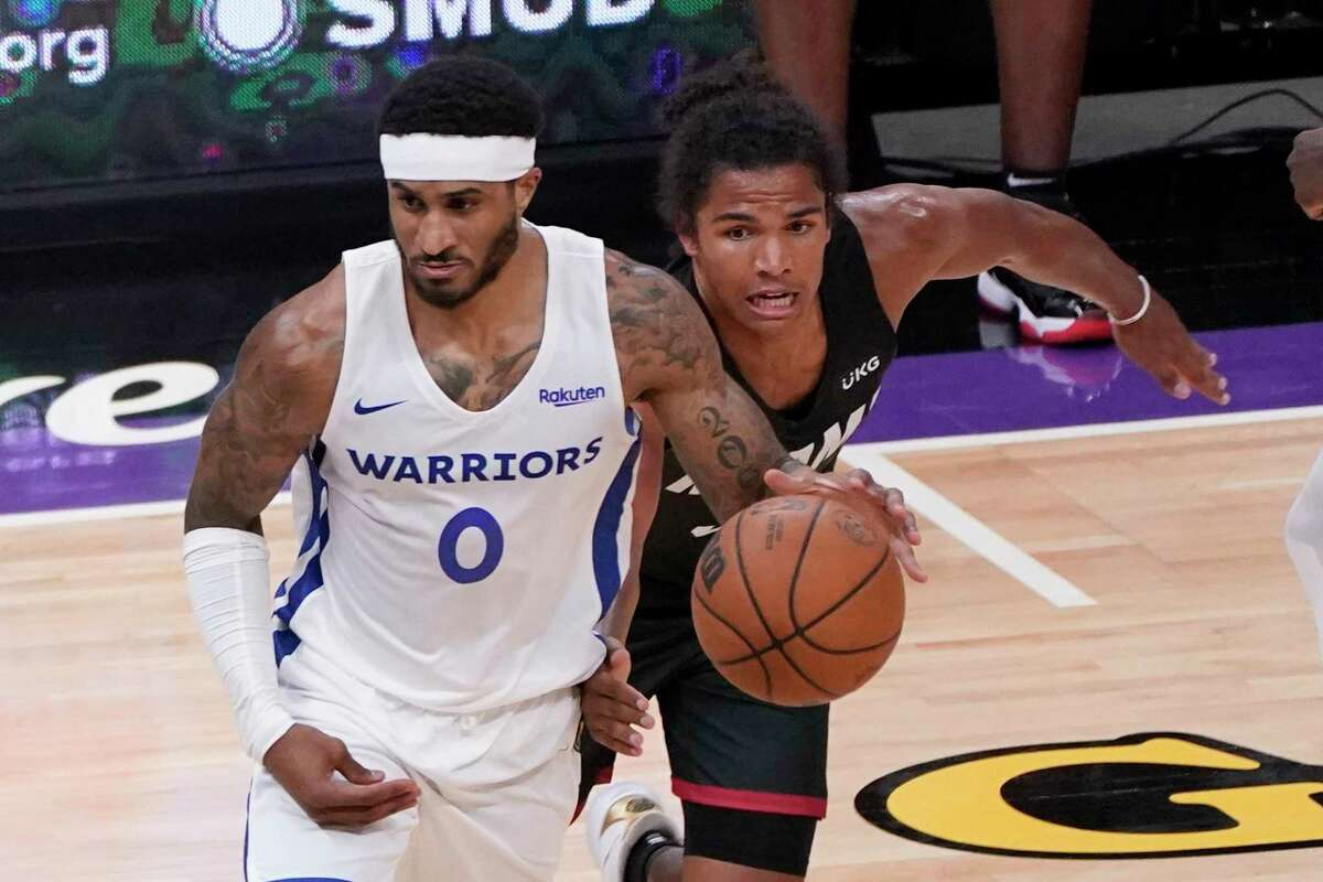 Miami Heat guard Dru Smith, right, tries to steal the ball from Golden State Warriors guard Gary Payton II during the second half of a California Classic NBA summer league basketball game in Sacramento, Calif., Wednesday, Aug. 4, 2021. (AP Photo/Rich Pedroncelli)