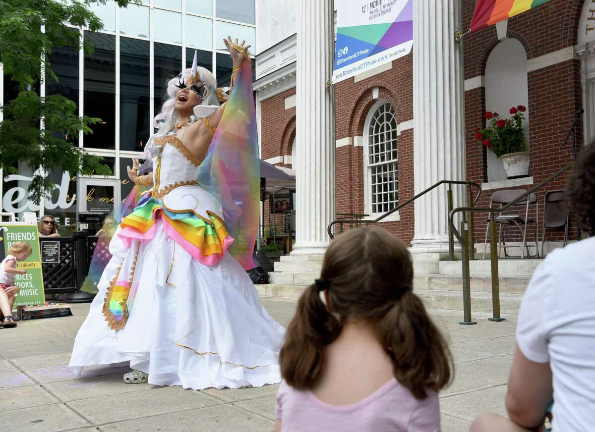 Robin Richards of Stamford performs a song for an audience outside of the Ferguson Library in Stamford on Saturday. The Ferguson Library hosted an outdoor drag storytime, featuring three drag performers. The storytime was part of Stamford Pride activities put on by the city's LGBTQIA organization.