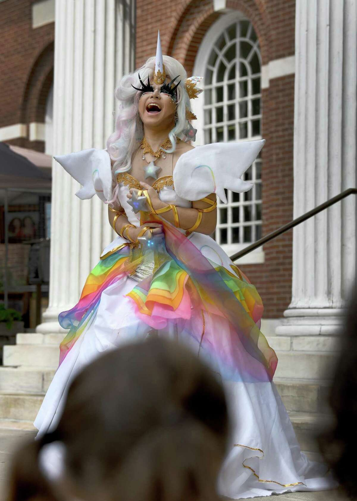 Robin Richards of Stamford performs a song for an audience outside of the Ferguson Library in Stamford Saturday, August 7, 2021. The Ferguson Library hosted an outdoor drag storytime, featuring three drag performers. The storytime was part of Stamford Pride activities put on by the city's LGBTQIA organization.