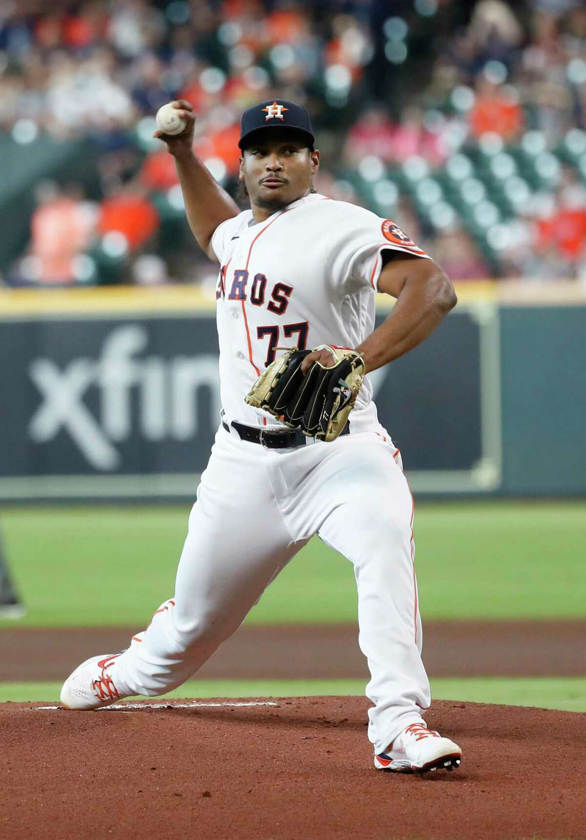 Houston Astros starting pitcher Luis Garcia (77) pitches during the first inning of an MLB baseball game at Minute Maid Park, Saturday, August 7, 2021, in Houston.