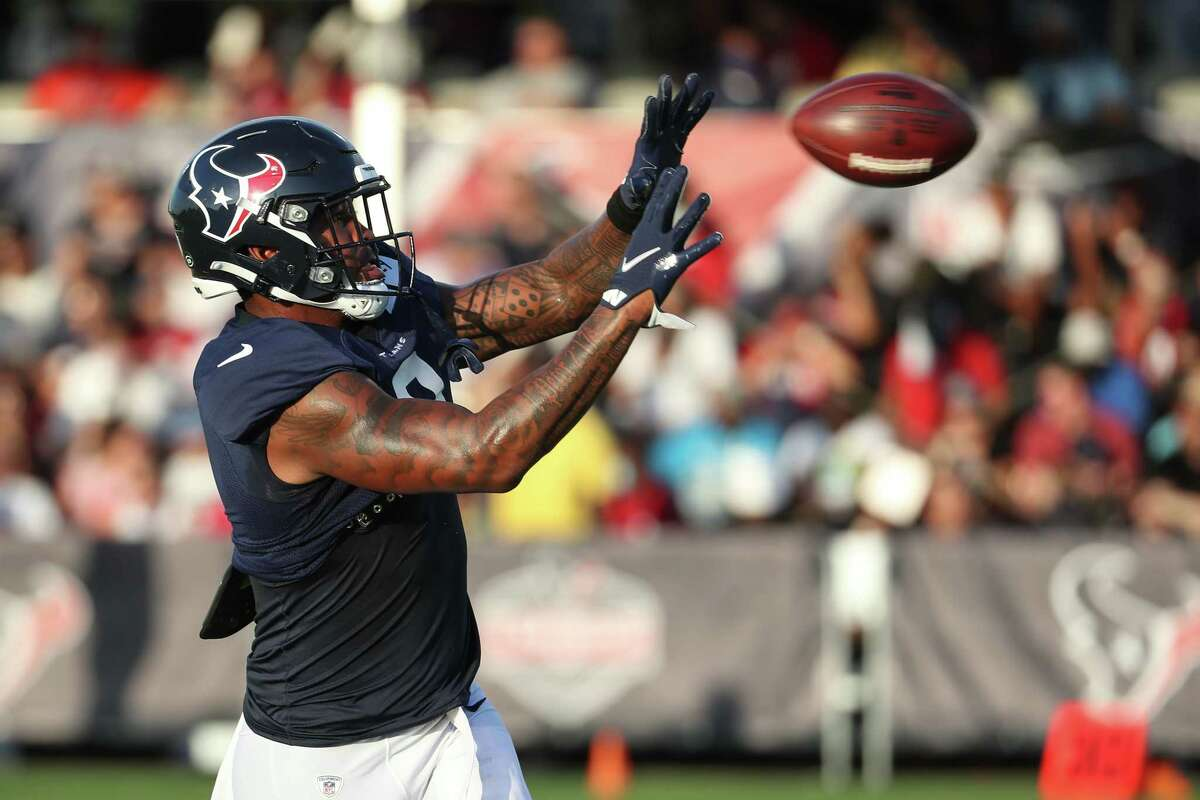 Houston Texans tight end Brevin Jordan turns to make a catch during an NFL training camp football practice Saturday, Aug. 7, 2021, in Houston.