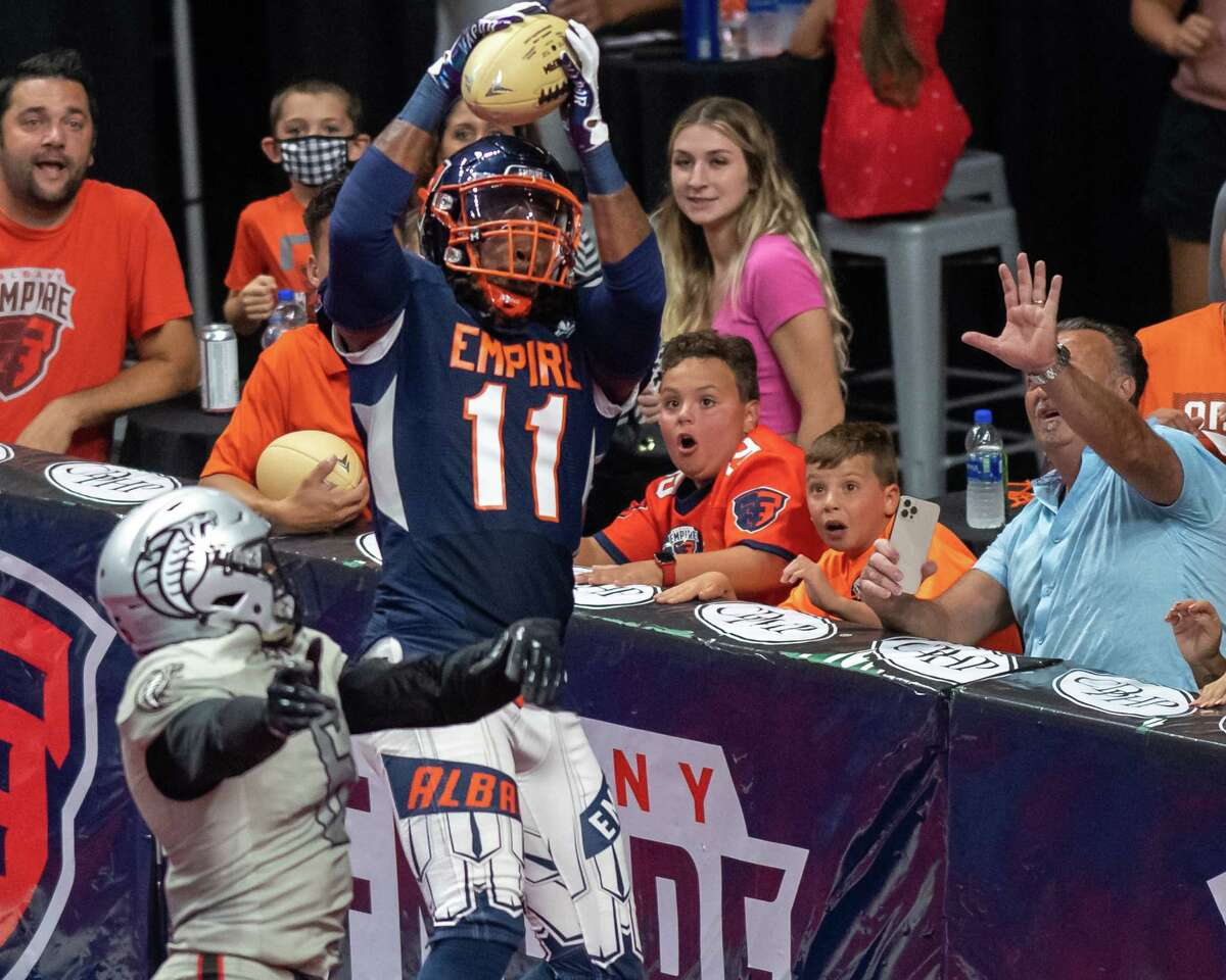 Albany Empire receiver Phillip Barnett catches a touchdown in front of Carolina Cobras defender Thyron Lewis during the National Arena League playoffs at the Times Union Center in Albany, NY, on Saturday, Aug. 7, 2021. (Jim Franco/Special to the Times Union)