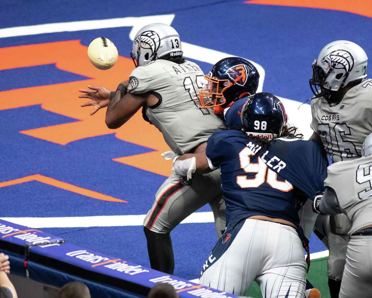 Albany Empire defenders knock the ball out of the hands of Carolina Cobras quarterback Aaron Aiken as he crosses the goal line during the National Arena League playoffs at Times Union Center on Saturday, Aug. 7, 2021.