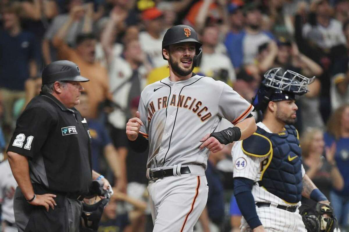 MILWAUKEE, WISCONSIN - AUGUST 07: Kris Byrant #23 of the San Francisco Giants scores in the ninth inning against the San Francisco Giants at American Family Field on August 07, 2021 in Milwaukee, Wisconsin. (Photo by Quinn Harris/Getty Images)