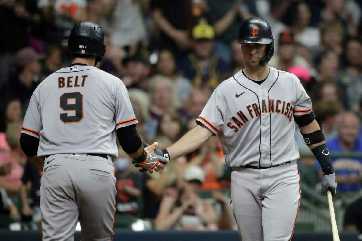 San Francisco Giants' Brandon Belt (9) is congratulated by Buster Posey after hitting a solo home run during the fourth inning of the team's baseball game against the Milwaukee Brewers on Saturday, Aug. 7, 2021, in Milwaukee. (AP Photo/Aaron Gash)