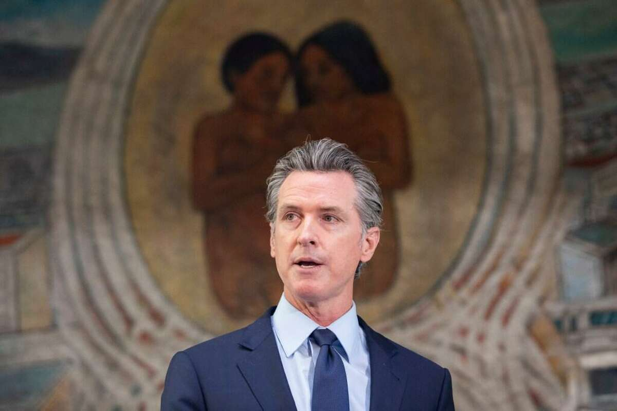 Gov. Gavin Newsom, the target of the recall election, addresses a crowd at the Unity Council career center in the Fruitvale district of Oakland in May.