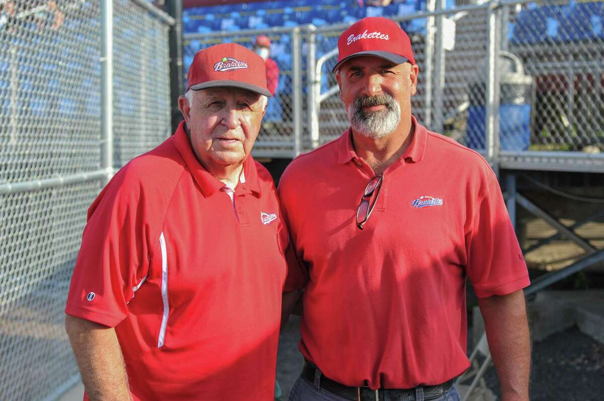 Manager John Stratton (left) and Assistant coach, son Jay Stratton (right) of the Stratford Brakettes Softball Team