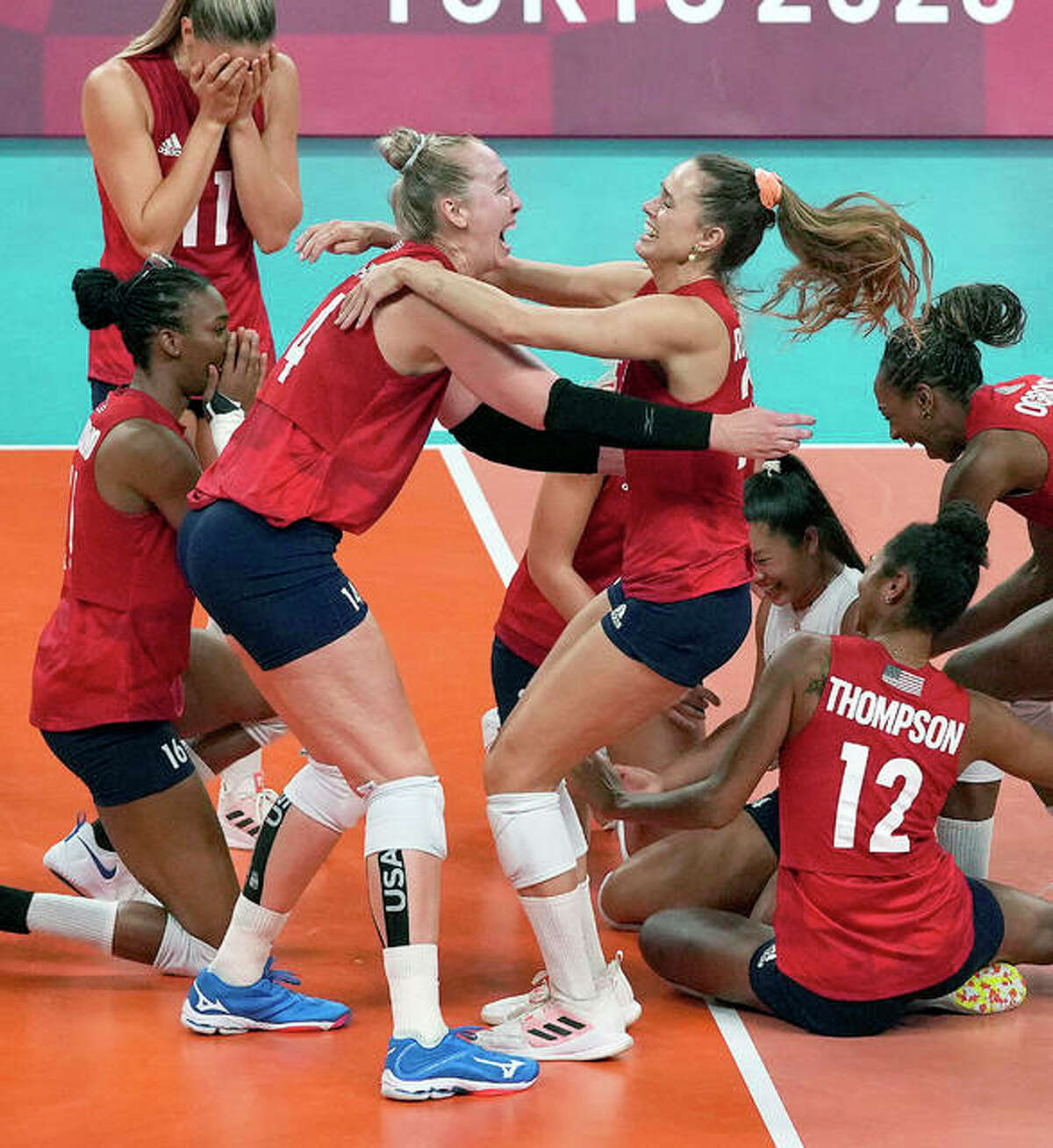 Collinsville native Michelle Bartsch-Hackley, left and teammate Kelsey Robinson celebrate with teammates after the US women's volleyball team defeated Brazil 3-0 Sunday to win the gold medal match at the Tokyo Olympic Games. Bartsch-Hackley is a 2008 graduate of Collinsville High and, along with fellow Olympian Jordyn Poulter, a former standout at the University of Illinois.
