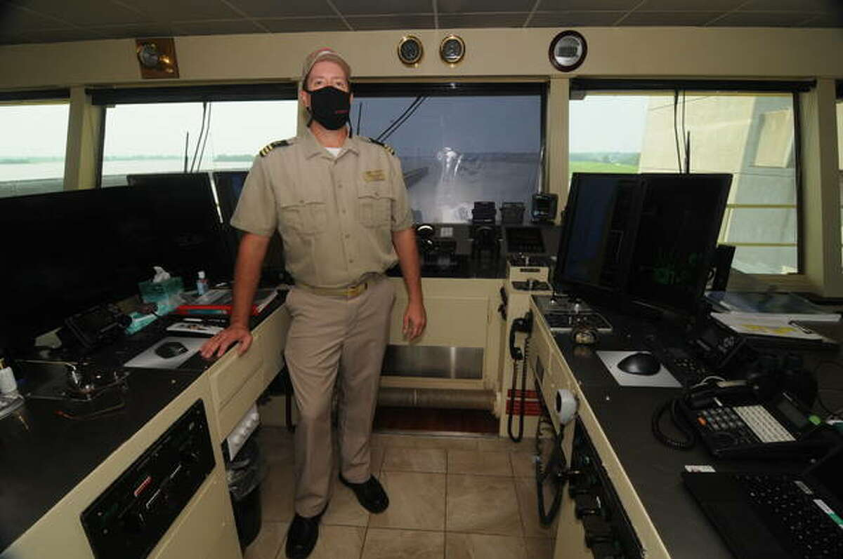 Jeffrey Hopkins, the assistant master of the MV Mississippi, greets guests to the boat's control room.