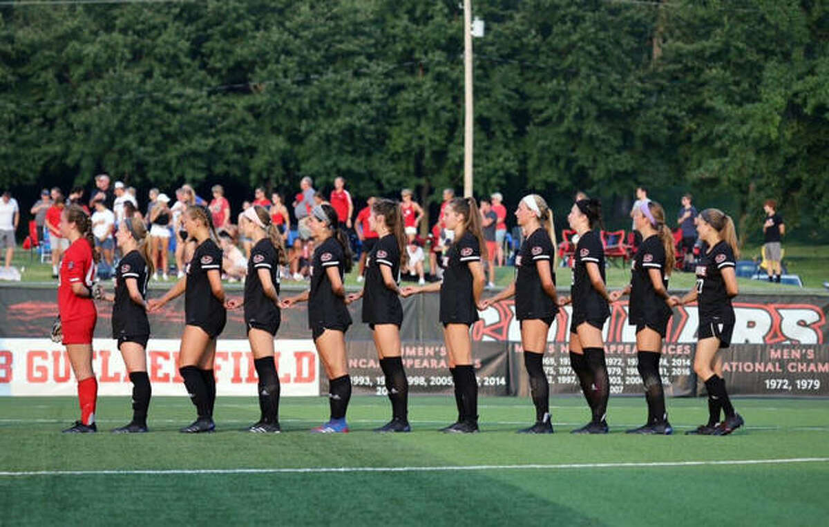 The SIUE Cougars stand for the US National Anthem before the start of their game against the Saint Louis University Billikens on Saturday in Edwardsville.